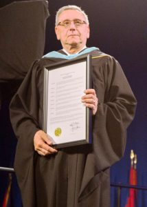 Paul Rigda, LCCC alum and retired Superintendent of Elyria City Schools, received a resolution of gratitude from the LCCC District Board of Trustees during the 2015 LCCC Commencement ceremony.