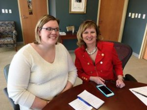 A blond woman sits to the left of LCCC President Marcia Ballinger in the president's office.