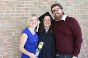 Christine celebrate graduation with her son and niece.