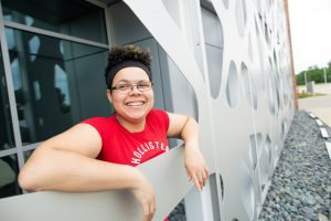 Simone Yalanty leans on a railing on the LCCC campus